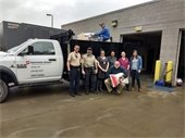 Photo of Southern States staff donating dog food to Orange County Animal Shelter.