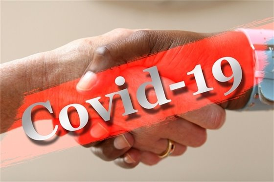 image of covid-19 and people shaking hands