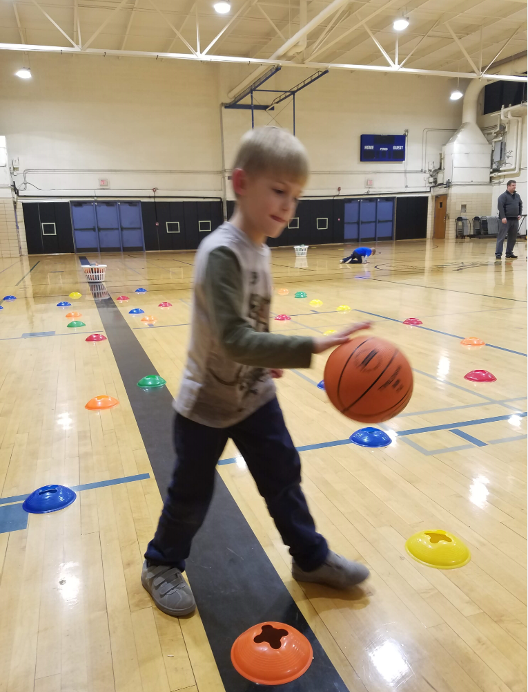 Boy dribbling basketball in Start Smart