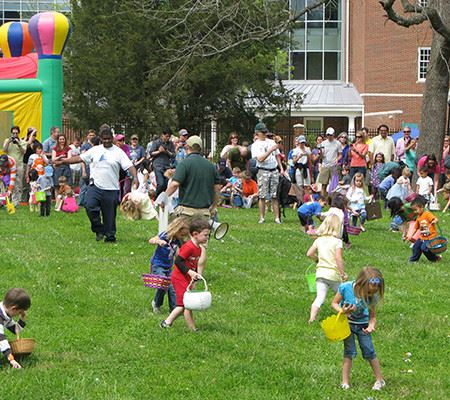 Small children outside during Easter egg hunt