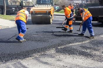 Photo of a road crew working