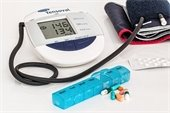Blood pressure cuff, medication and pill sorter.