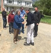 Photo of Governor Cooper and Chair Penny Rich shaking hands.