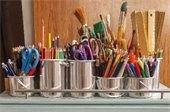 Art supplies in tin buckets.