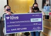 Photo of OCAS staffers holding Petco Grant check