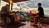 Doug Largent Trio performing outdoors.