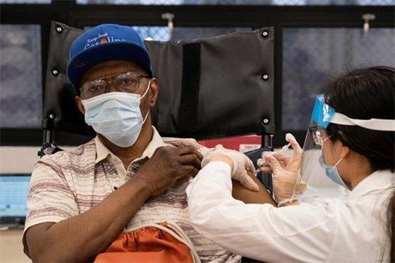 Black man receiving COVID-19 vaccination