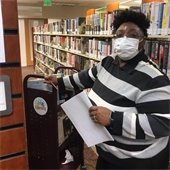 Photo of library staff preparing materials for curbside