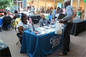 Photo from Orange County Job Fair showing man at Census booth