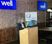 Photo of Chair Penny Rich speaking at Well press conference