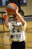 Young child shooting basketball