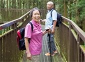 Older Asian couple on a nature hike.