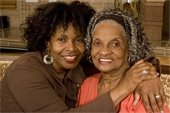 African-American daughter with elderly mother