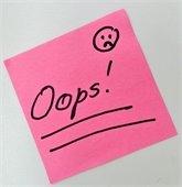 """pink post it note with the word """"oops"""" on it"""