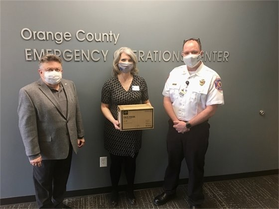Photo of Medline presenting masks to Orange County