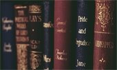 "Photo of old vintage books, including ""Pride and Prejudice"" by Jane Austen."