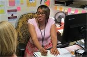 Orange County Department of Social Services, Social Worker, Keisha Andrews, MSW, in her office counseling a client.
