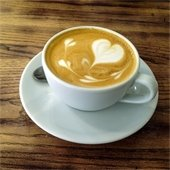 Cup of coffee with heart shaped cream.