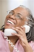 Closeup image of an older African-American woman talking on the phone.
