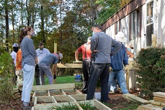 Photo of people building a ramp