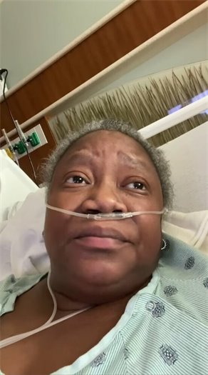 Dr. Susan Moore in hospital bed