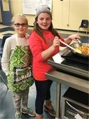 Two children at cooktop in Junior Chef