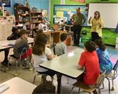 Chair Penny Rich and Commissioner Mark Marcoplos discuss climate change with fifth graders.