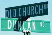 Street sign for Old Church Road and Duncan Road intersection