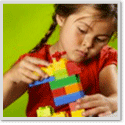 Girl Building with Legos