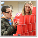 Two Kids Stacking Cups