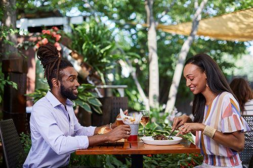 African American couple dining on the patio at Acme Restaurant